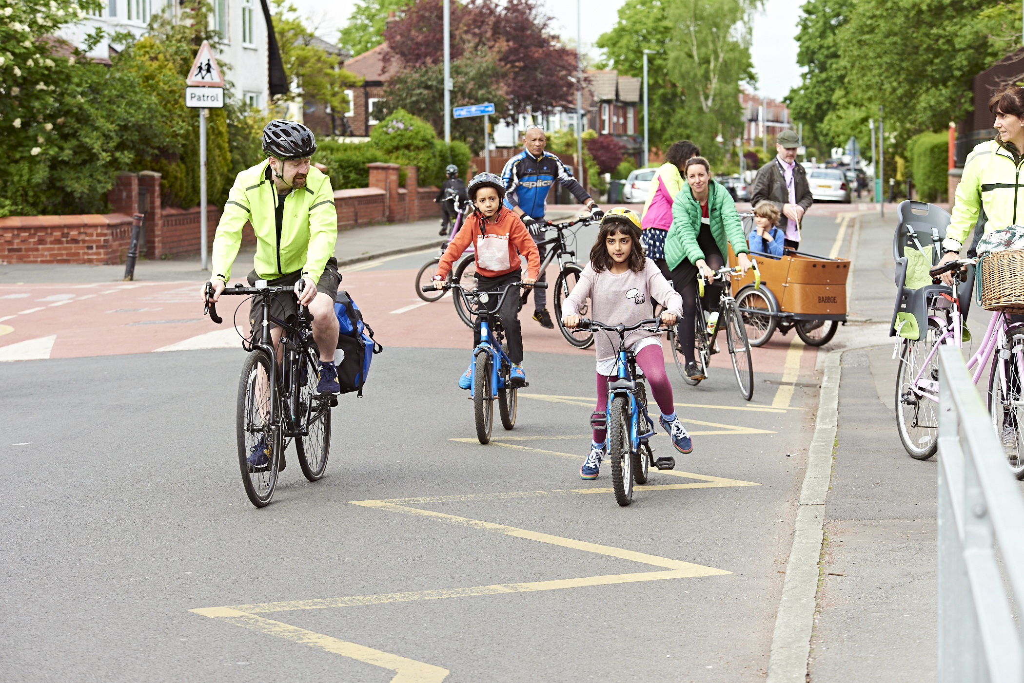 children and adults riding bikes