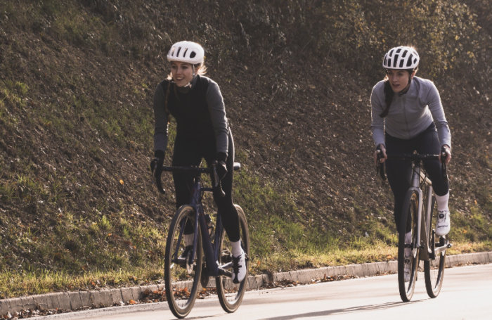 Female cyclists going uphill