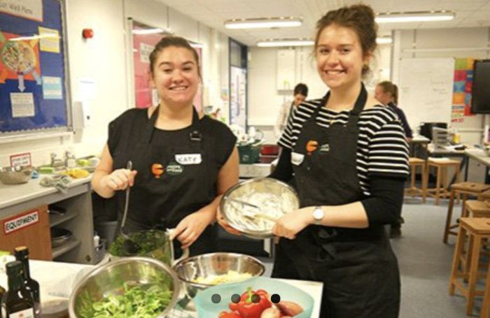 Two female participants at cooking school