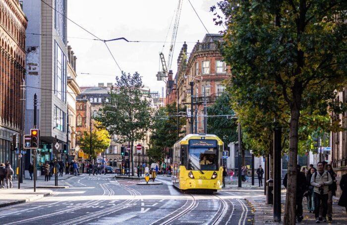 Tram travelling through Manchester City Centre
