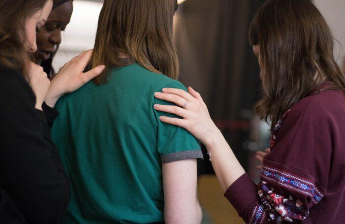 Women consoling a friend